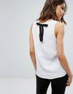 Get this New Look's sleeveless top now! Click for more details. Worldwide shipping. New Look Tie Back Shell Top - White: Top by New Look, Lightweight woven fabric, Crew neck, Sleeveless design, Contrast tie closure, Regular fit - true to size, Machine wash, 100% Viscose, Our model wears a UK 8/EU 36/US 4 and is 170cm/5'7 tall. Transforming the coolest looks straight from the catwalk into wardrobe staples, New Look joins the ASOS round up of great British high street brands. Get it or regret…