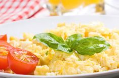 Serves 2    1 TBS Olive Oil,  3 whole eggs,  1 TBS filtered water  1 TBS lemon rind,  10 Fresh basil leaves washed,  6 cherry tomatoes halved,  Sea salt, to taste,  Drop of olive oil for garnish    In a bowl, combine eggs, water, sea salt
