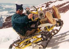 The Snowpod is a snow and ice sled designed for use by individuals with lower extremity or mobility disabilities or spinal cord injury. This arm-powered sled has a bicycle chain drive with snowmobile tracks instead of wheels, and a 49-speed 7 x 7 gearbox with independent track drives (forward and reverse)