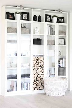 LOVE the idea of using a bookcase to store wood! Clever