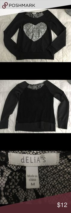 Lace back Delias long sleeve. Delias long sleeve with a cute full lace back. Loose fit. I would normally wear it with a black tank top or a cute bralette :) Tops