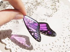 I so want to have a go at making these!,  Resin Transparent Morpho Earrings Rainbow by YaTomkaStore on Etsy