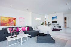 Like the idea of colourful pillows on grey sofa.