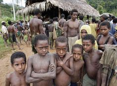 Papua New Guinea people eyeing the camera.