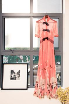 Inside Jewelry Designer Ana Khouri's Closet: Pink Gucci swan-print dress with bows on the front | coveteur.com