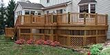 Wooden Deck by Elyria Fence