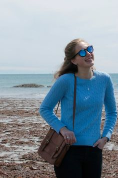 Periwinkle blue cable knit sweater, black skinny jeans, blue lense sunglasses for a cute fall look