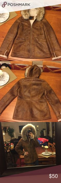 Bernardo brand fur hood coat Fur hood is 100% wool, lined with soft faux fur, outside is soft suede-like material. Like new. Warm and comfortable. Bernardo Jackets & Coats