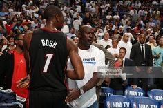 Majority owner, Michael Jordan, of the Charlotte Bobcats greets Chris Bosh #1 of the Miami Heat after Game Four of the Eastern Conference Quarterfinals in the 2014 NBA Playoffs at the Time Warner Cable Arena on April 28, 2014 in Charlotte, North Carolina.