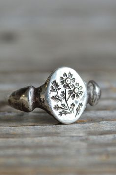 We love the vintage feel of this recycled metal ring.