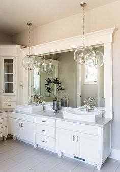 Although I like the idea of an LED mirror, I like these 2 large pendants hanging in front of large vanity mirror and how they sparkle and reflect. ALSO, for corner that would be created in bath, could install a CORNER storage unit.