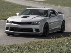 The 2014 Chevrolet Camaro Z/28 shown completing the grueling 24-hr test of the car on several tracks around the world for a total of 24 track times during which the only mechanical changes allowed are replacing the brakes and tire