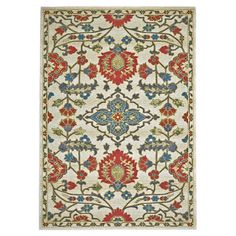 Accent a boho-chic space or anchor a neutral seating group with this eye-catching rug, featuring an artful botanical motif.   Produc...