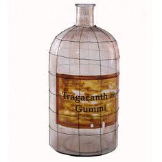 Botella decorativa modelo Tragacanth con malla, elaborada en cristal color transparente.      Ancho: 26 cm     Largo: 26 cm     Alto: 53 cm     Color: Transparente