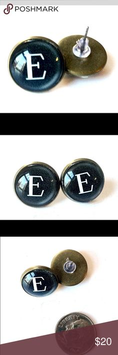 Typewriter Key Post Earrings Letter E Monogram Super cute, unique, post earrings featuring the image of a typewriter key underneath glass, set in an antique bronze colored setting. Brand new, handmade by me and packaged in a unique box to keep it safe in transit. These go with everything and will win you tons of compliments! Also available in a smaller circumference and in other letters/keys. These are 14mm, see photos for scale. Discounts on bundles and reasonable offers considered…