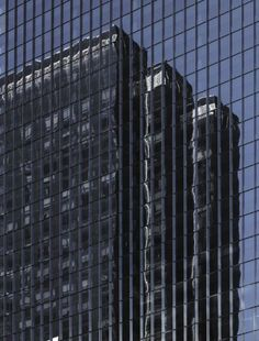 Three buildings of New York Skyline reflected in glass windows