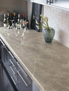 Laminate countertops are an inexpensive, low-maintenance alternative to pricey stone and solid-surface countertops, and they are available in many styles that mimic expensive surfaces such as granite or marble. Laminate countertops are not resistant to heat and can scratch. Image courtesy of Formica Corp.