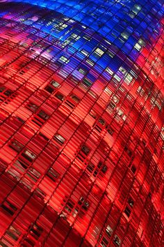 Torre Agbar - Close-up view of the illuminated facade of Torre Agbar in Barcelona by Krzysztof Kusy Blue Shades Colors, Shades Of Red, Barcelona Travel, Barcelona Spain, Love Blue, Red White Blue, Red Fish, World Of Color, Best Cities