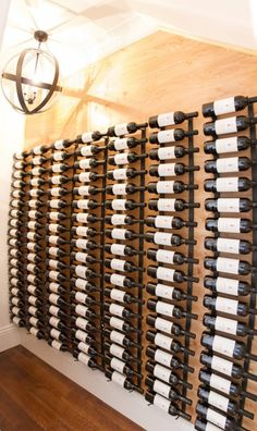 Inexpensive wine storage options backed by texture on wall