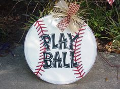 Large hand painted Baseball Door Hanger or Room Décor Sign. Would look great on the door or hanging on the wall at your door entrance. Can also be painted as a softball in yellow.  It measures 20 I also have a smaller version listed.  Item is made of approx. 1/4 wood, painted and sealed with a protective finish.  The baseball has an attached wire for hanging. Ribbon is optional and removable. Personalization at no extra charge- Name, Number, Play Ball, Initial  All writing will be hand p...