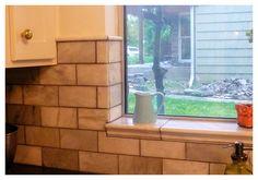 Crema marfil tile with giallo ornamental granite counter for Galio counter