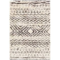 A neutral rectangular area rug with a soothing Southwestern pattern and generous shag pile design.