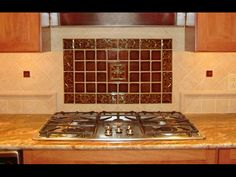 I like the idea of a pop of color (if the rest of the back splash is fairly neutral) behind the stove.  Not this tile though ... it's not our style