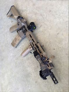 AR-15 in FDE with Magpul Furnitures, Troy BUIS, Troy TRX Rail, Aimpoint T1-Micro, Gieselle 3G Dynamics Trigger, Battle Arms Dev Ambi-Safety Selector, BCM Charging Handle, Daniel Defense BCG, Spike's Tactical Buffer, VLTOR Buffer Tube, Spike's Tactical/FN Cold Hammer Forged M249 Barrel, SureFire Muzzle Brake, SureFire M951 Light with IR Filter and remote switch, Tango Down Vertical Grip.