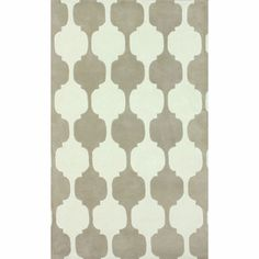 The geometric design on this area rug looks a bit like chess pieces.