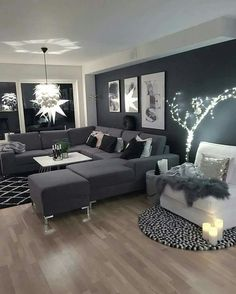 ABSOLUTELY STUNNING, THE ENORMOUS DARK GREY SOFA, MATCHING FEATURE WALL & QUITE SIMPLE DECOR!! - THEN COMES THE 'TOUCH OF LUXE' WITH THE FABULOUS LIGHTING & SILVER CUSHIONS!#️⃣