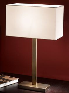 TL876/9867 Rectangle table lamp, bronze & off white shade. Bronze finish rectangle section table lamp with a off white rectangle shade and in-line switch 1 x 60w E27 Lamp not included  Height- 63.5cm Width- 35cm x 17.5cm Base Width- 20cm x 9.5cm  BRAND- Franklite REFERENCE- TL876/9867 AVAILABILITY: 3-4 Working Days **Can be supplied with electronic controle gear and low energy Lamps.     (where item is suffixed EL it is automatically supplied with gear & lamps) **Can be sup...
