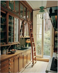 The warmth of wood in the kitchen. Love the ladder for the higher cabinets.
