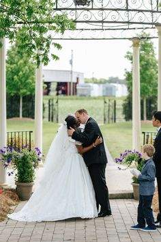 Newly married interracial couple sealing their vows with a kiss #love #wmbw #bwwm