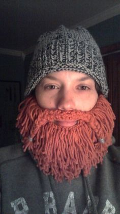 Free knitting pattern Mountain Man Bearded Hat - Designed by Kate Agner, this classic bearded hat has variations from well-groomed to Robinson Crusoe! Goes well with the Viking Helmet hat on same page