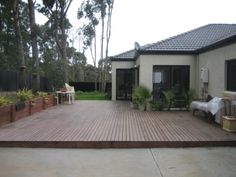 Low, modern deck ideas. Veggie planters there?