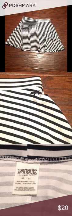 Pink Victoria's Secret Skirt. Size M. Pink Victoria's Secret Skirt. Size M. Black and white stripes. 94% cotton 6% elastane. Has a small snag as shown in picture otherwise in great shape! PINK Victoria's Secret Skirts