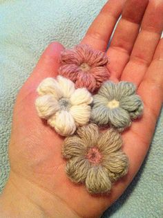 Ravelry: Project Gallery. Crochet hair accessories made using Mollie Flowers pattern by Brigitte Read. Cascade 220 heathers.
