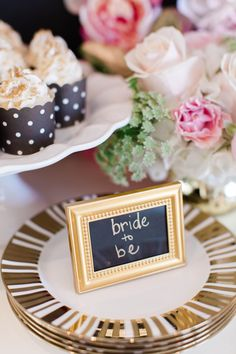 Use a stylishgold frameto serve as a place card setting and allow guests tosave their favor for a favorite photo of their own. | Ashley Steeby Photography