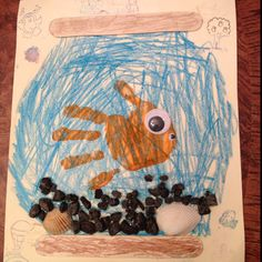 Babysitting craft: Fish hand print, shells, gravel, and popsicle sticks.