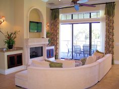 Main living room part of this great room overlooking the pool and golf course