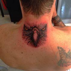 Eagle face tattoo
