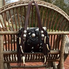 The Bonnie Bag, with side pockets lined in suede, antler tips, and the owners own conchos. Custom bags and totes from gowestdesigns.us