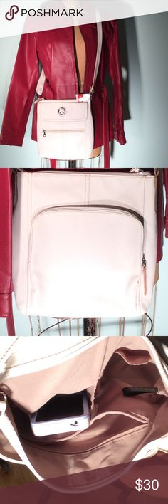 "Relic white leather Xbody w/loads/compartments-NWT New With Tags white pleather Relic cross body. Design is called Erica Flap presumably be coz of the logo flap on front. Just 1 of 3 exterior pouches: flap & zipper on front, zipper with credit card/i.d. pouches within. Zipper closure on top with 2 cellular phone size pouches & one zipper pocket inside. Adjustable shoulder strap from 25""-48""ish. VEAGN. PM444 Relic Bags Crossbody Bags"