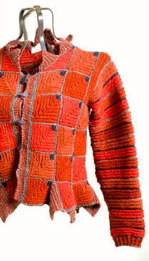 photo of an interesting knitted jacket - could crochet.