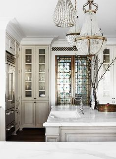 Victorian doors from Newel. Custom joinery by VRD Detailed Joinery with hardware from Restoration Hardware. - Stunning and dramatic kitchen with an old-world feel