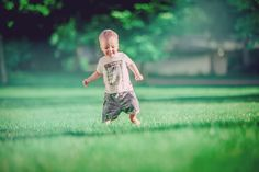 Little kid running in green grass / Children photography