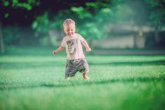 Little kid running in green grass / Children photography