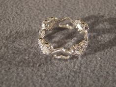 Vintage Sterling Silver 48 Round Cut Diamond Classic Heart Shaped from nicosnostalgia on Ruby Lane