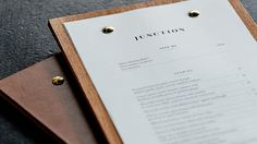 Wooden menu boards with brass screw detail for restaurant Junction Moama designed by Seesaw