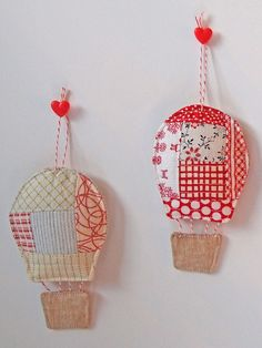 So cute!! Must make for near bub's cot.    hot air balloon ornaments by Spotted Stone Studio {Krista}, via Flickr
